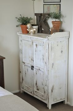 distressed dresser and industrial letter.