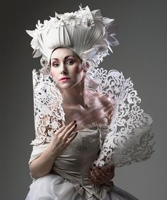a specially crafted paper shawl accompanies the model wearing paper wig