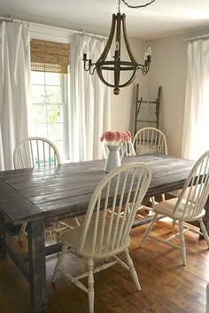 Love those chairs and the distressed wood. I want a little more finish than that, but like that it's not too shiny