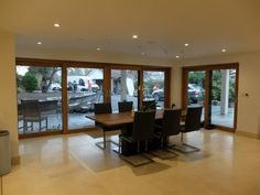 oak sliding doors and yes you guessed they are well protected externally with a shield of aluminium Windows And Doors, Sliding Doors, Conference Room, Table, Furniture, Home Decor, Sliding Gate, Decoration Home, Room Decor