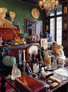 Collection of Wiccan things. Could be where a altar is made.  My desk is similar to this, I put together an altar in this space when I need to.