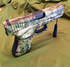 Glock 19 Gen 4 wrapped in ATACS FG. Find our speedloader now! http://www.amazon.com/shops/raeind