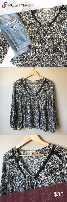 """Anthropologie Eri + Ali black and cream top Adorable flouncy and flowy fit. Flare sleeves and embroidered v neckline. Sweet floral pattern. Super flattering and perfect for spring paired with jean and boots! In perfect condition with zero flaws.  Bust: 18"""" Length: 23"""" Anthropologie Tops Blouses"""