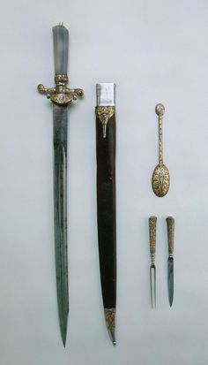 Hunting Dagger with Accessories (spoon, fork and knife). Place of creation: Russia. Date: Circa 1750. School: Tula. Material: steel, gold, wood, leather and coloured stone. Technique: forged, chased, engraved, etched, damascened and polished.