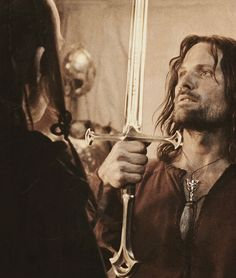 """Put aside the ranger. Become who you were born to be."" Andúril sword"