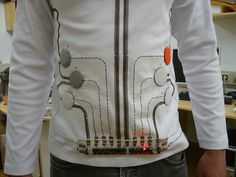 A Toy Piano embedded on a T-shirt. It has 8 keys from Do to Do (1 octave). You can play simple music by wearing the shirt and pushing the fabric button on the shirt. All the components from the toy piano (batteries, speaker, circuit board) are placed on the shirt and connected with poppers. All these hard components are detachable so that you can wash it if you wish.