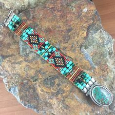 This beautiful & intricate Beaded Bracelet from Chili Rose Beadz incorporates hundreds of Beads hand woven to an impressive display of color & patterns. The Artist uses beads from around the world, al