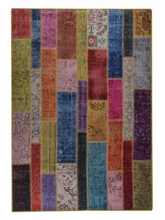 ADNA Vintage in Multi is a handmade rug, made of 100% polyester. Made in Turkey