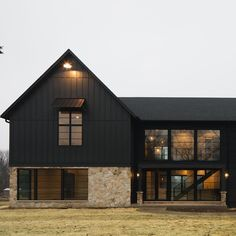 Gendai in Ebony on a striking modern farmhouse design. Wonderful custom build by M House Development in Naperville, IL. Pull Barn House, Modern Barn House, Barn House Plans, Modern Farmhouse Design, Modern Farmhouse Exterior, Haus Am See, Black House Exterior, House Siding, Style At Home