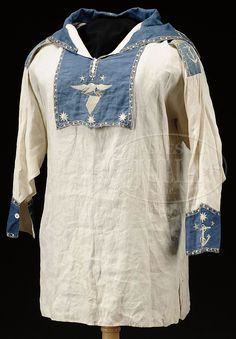 James D. Julia, Inc. -  1830-1840 Sailor's Jumper, blue panels with silk embroidery.