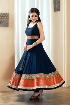 Amazing blue anarkali suit crafted in net material: Stand out from the rest wearing this sunning blue color anarkali suit crafted in net material. Edge of the kameez is engraved with laces worked with stones , sequins and zari work.