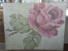 Giant cross stitch! Made with pegboard and yarn. Neat!