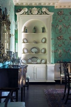 Dreamy green---I love the built- in cupboard and dentil moulding.