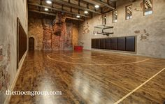 Sophisticated basketball court in a house. It also has a rock climbing station. Home Basketball Court, Basketball Room, Basketball Tricks, Sports Court, Basketball Uniforms, Basketball Shoes, Basketball Stuff, Basketball Leagues, Home Sport