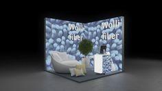 351 Heimtextilien Wolli fiber | Schöner Messestand für einen Hersteller von Heimtextilien.  Die hohen, rahmenlos bedruckten Leuchtwände mit dem Motiv einer blauen Textilfaser lenk...