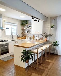 Beautiful kitchen, super clean and open concept! Loved the bench and the plants . Home Kitchens, Kitchen Design Small, Home Decor Kitchen, Kitchen Room Design, Kitchen Interior, Interior Design Kitchen, Small Modern Kitchens, Kitchen Furniture Design, Modern Kitchen Design