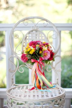 Bright color bouquet looks lovely with loads of colorful ribbon.