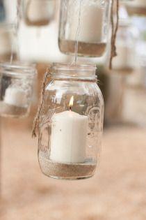Hanging mason jar candles. Great for a rustic wedding #wedding #rustic #decor