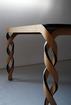 Paul Loebach's Watson table, which was shown at Carwan Gallery, has double-helix legs and is made of wood and carbon fiber.