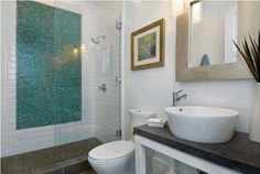 To da loos: 11 tile pattern ideas for your glass shower  Using white subway tile with the glass tile to cut the cost
