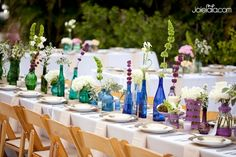 I like the use of different coloured vases and bottles for table decoration, from Karrie + Tim at Anna Maria Island Florida, Photography by Joielala