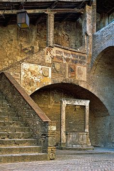 The courtyard inside the Palazzo Comunale of San Gimignano, built in 1288. The town of San Gimignano, near Siena, Tuscany, Italy represents one of the best preserved examples of medieval architecture in Italy. Its historic centre is a UNESCO World Heritage Site
