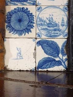 Vintage blue and white Delft tiles. Love the sunflower