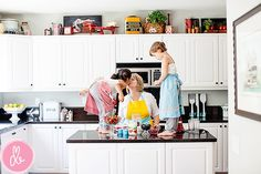 Above the cabinets | Love the antique-y kitchen/food related items: tin flour canister, picnic basket, red scales, faux apples, etc. <3 <3 <3