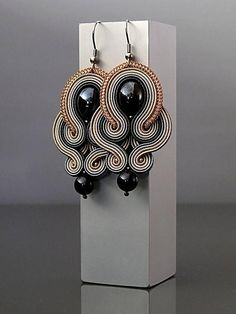 Beautiful, impressive Soutache earrings, made of Soutache strings and glass beads. Full length: 2 inches. Colour: shades of beige, shades of gray and graphite.