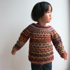 Beautiful baby sweater!  Barnetrøje i hulkrus by Helga Isager