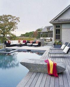 Note: Real rock diving board against modern design.  Love.
