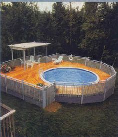Above ground pool decks designs - I like the covered seating area on this deck.