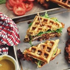 bacon cheddar green onion waffles serve as bread for this fried chicken sandwich. maple mustard sauce included.