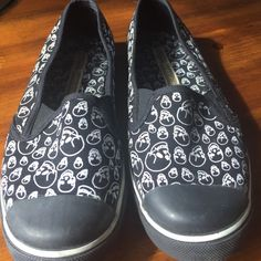 ONE OF A KIND CUTE SKULL SLIP ON SHOES!!! I love these shoes! They are to small for me. They say they are an 8 but fit more like a 7. Great condition! Buffalo Shoes Flats & Loafers