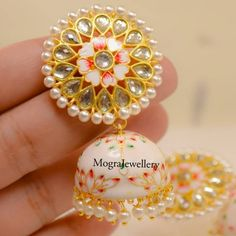 Price is 950 rs and free shipping in India. . . Real meenakari hand made earrings with kundan and Pearls. . . .For all the colours options… Silver Jhumkas, Gold Jhumka Earrings, Indian Jewelry Earrings, Indian Jewelry Sets, India Jewelry, Ethnic Jewelry, Jewelry Art, Fashion Jewelry, Jewelery