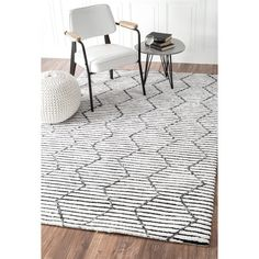 Quality meets value in this beautiful modern area rug. Handmade with Polyester to prevent shedding, this plush area rug will enhance any home decor. Pile Height: 0.25 - 0.5 inch Material: Polyester St