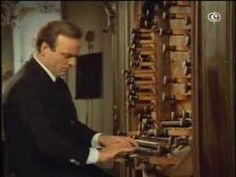 J.S.Bach - Toccata e Fuga BWV 565 - Karl Richter - uploaded by IIIMeLkOrIII. Great video that shows the four keyboards, foot pedals, stops, organ pipes, and the guy behind the organist helping pull the stops.