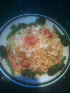 Pasta with flaked Alaskan red salmon,organic cherry tomatoes,garlic,chili flakes,chopped avocado,purple sprouting broccoli lightly warmed in organic olive oil ! Dinner tonight.