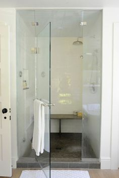 Lovely Walk In Shower Features Seamless Gl Door As Well White Subway Tiled Walls And Ceiling Rain Head Niche Gray