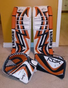 """Originally, the leg pads were White and Black and the gloves were White, Black and Silver. Our customer purchased our original Orange colour and customized them all to her satisfaction. It's a great """"busy"""" look. Of course, everyone has their own idea of what they want their pads and gloves to look like and with our premium product, you can create almost anything you want. With all our new colours, you have more options today than ever! www.padskinz.ca Hockey Gear, Ice Hockey, Goalie Pads, Golf Bags, Nhl, Color Change, Orange Color, Gloves, Legs"""