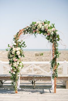 Brides.com: . A classic, floral-covered wedding arch, created by Teresa Gausman of Premiere Events.