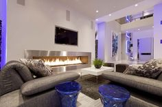 Modern Living Room With Grey Sofas And White Table Facing Modern Long Fireplace