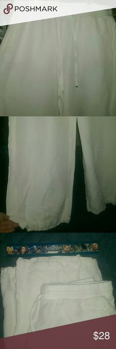 Lane Bryant linen trousers Perfect for summer! Uber comfy, delicate, soft, bright white, 55 linen 45 rayon pants. Wide, swoopy legs. Drawstring waist. Pockets!!! Never worn!! Apologies for the crappy photos. These are roomy leg pants and wrinkly linen and hard to photograph. I'm happy to answer any questions or take a specific photo for you to help with any concerns! Lane Bryant Pants Wide Leg