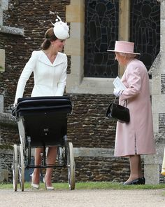 Catherine, with her grandmother-in-law Queen Elizabeth II, at Princess Charlotte's Christening at The Church of St. Mary Magdalene, Sandringham, Norfolk, July 2015