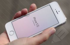 free iPhone 5s being held in hand mockup