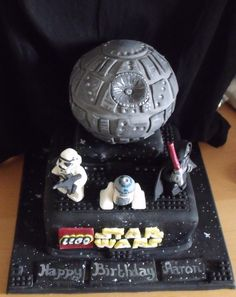 Lego star wars cake with fondant r2d2, clone trooper and darth sidious. Death star made from rice krispie treats