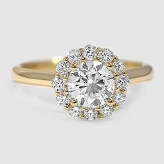 A romantic yellow gold halo engagement ring.