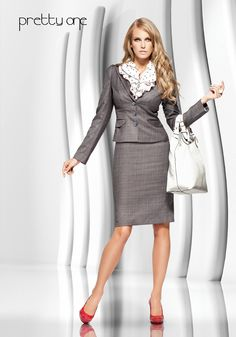Blouse and shoes add interest to conservative suit.