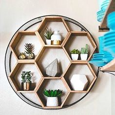 We love how @forever_inbloom styled our Round Metal and Wood Honeycomb Wall Storage. Encircled by a metal and chicken wire frame, our wall unit houses a honeycomb of hexagonal wooden cubbies, lending a warm, homey feel to your space. (link in profile to #shop) #WorldMarket #HomeDecor