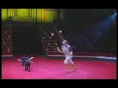 Unique Animal Circus Act - a Juggler with Dogs